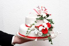 Stock Photo of Magnificent cake with red roses flowers in vintage style