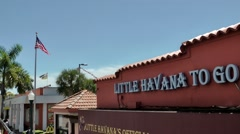 USA Florida Miami 076 Little Havana stroke at a facade; Stars and stripes flag Stock Footage