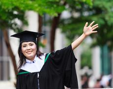 Graduation asian girls with congratulation Stock Photos