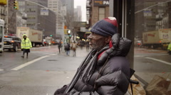 Homeless Man Wheelchair Unemployed Man Cup Disabled Black Man Winter 4K NYC - stock footage