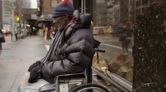 Homeless black man wheelchair with cup begging for change 4k Manhattan NYC Stock Footage