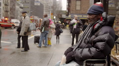 poverty-stricken man wheelchair cup begging for change 4k Manhattan NYC - stock footage