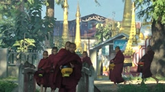 Young monks returning from alms round,Inle Lake,Burma Stock Footage