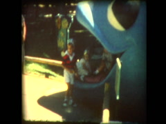 Kids climb into giant fish mouth at amusement park Stock Footage