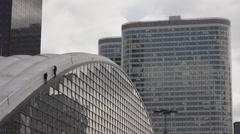 Dangerous job skyscraper cleaner in La Defense, Paris Stock Footage