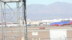 Passenger Jets Moving Behind Fence at McCarran Airport Las Vegas Stock Footage