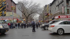 Busy East Village intersection with traffic cop in 4k, Manhattan NYC Stock Footage