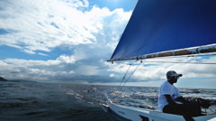 Skipper drives the traditional Philippines outriggers sail boat. Boracay Stock Footage
