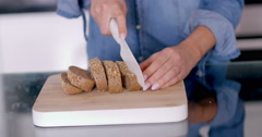 Slicing a Tasty Bread on a Wooden Chopping Board Stock Footage