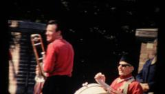 Musicians on the city. Vintage 8mm Stock Footage