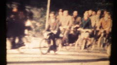 People on bicycles at the crossroads. Vintage 8mm Stock Footage