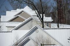 Cold Winter Snow  Covered Home Houses and Shadow Stock Photos