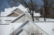 Stock Photo of Cold Winter Snow  Covered Home Houses and Shadow