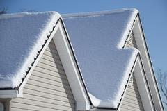 Cold Winter Snow  Covered House and Roof Stock Photos