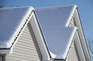Stock Photo of Cold Winter Snow  Covered House and Roof