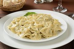 Farfalle pasta in pesto sauce - stock photo