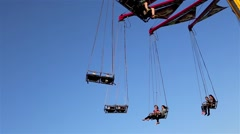 Fair ride shot against blue sky Stock Footage