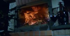Blazing fireplace in the evening in slow motion, beautiful fire Stock Footage