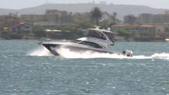 Motorboat crusing San Diego Bay Stock Footage
