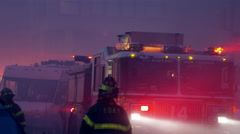 FDNY firetruck night with colorful flashing lights silhouette smoke 4K NYC - stock footage