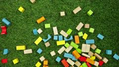 Color wooden blocks falling on the grass Stock Footage