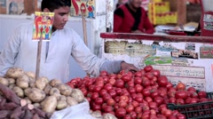 Arabic farmer market sell fresh fruits tomato potato and vegetables on a bazaar Stock Footage