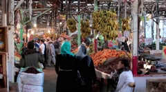 Arabic farmer market sell fresh fruits and vegetables on a covered bazaar - stock footage