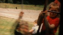 A child on a swing. Vintage 8mm Stock Footage