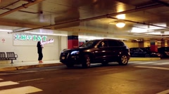 People and car passing the entrance of T&T supermarket Stock Footage