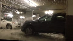 People washing car at underground car wash area. Arkistovideo