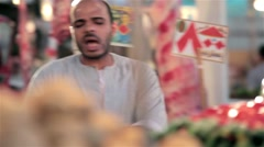 Arabic traditional farmer market sell fresh fruits and vegetables on a bazaar - stock footage