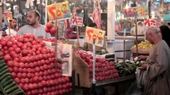 Arabic traditional farmer market sell fresh tomato vegetables on bazaar Stock Footage