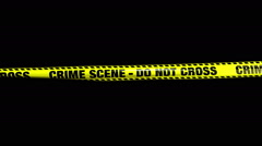 Crime Scene - Do Not Cross Yellow Caution Tape Stock Footage