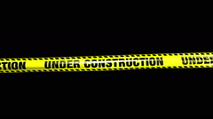 Under Construction Yellow Tape Stock Footage
