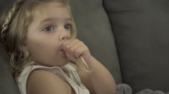 Little Girl Sucks Her Thumb While watching TV (3 of 4) - stock footage