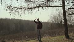 Tourist,glade,guy tired,Guy examines all around,man standing in a clearing Stock Footage