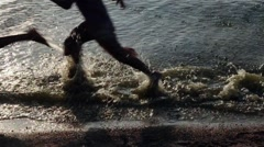 Two kids running at the sea coast - stock footage