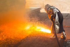Industry steel, Background peeling of slab, Flakes flame by blowing gas. - stock photo