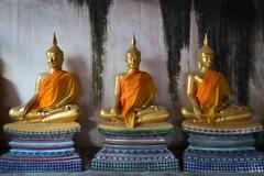 Old three Buddha statue in meditate posture - stock photo