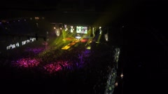 Flying over the stage and spectators at the concert. - stock footage