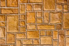 External brown stone wall background - stock photo