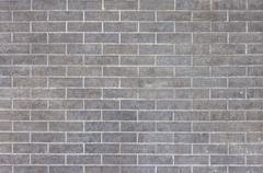 External grey brick wall background Stock Photos