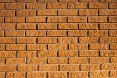 External brown brick wall background Stock Photos