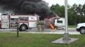 Handheld Shot Firemen Respond To Burning RV Footage