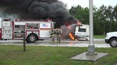 Handheld Shot Firemen Respond To Burning RV - stock footage