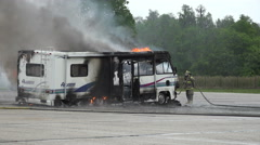 Smoking RV Fire In Parking Lot 01 Stock Footage