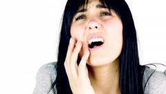 Young brunette woman feeling strong teeth ache isolated closeup - stock footage
