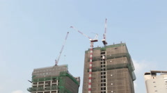 Building under contraction with crane Stock Footage