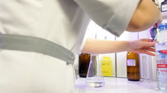 Lab assistant with test tube in a laboratory experiment. Stock Footage