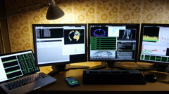 Hacker's desktop with triple monitor, laptop, mobile phone, tablet, Stock Footage